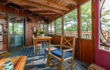 Summer Dining Area In Screen Porch